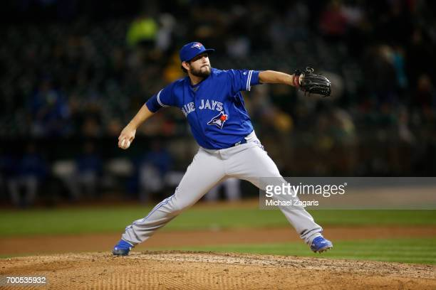 Dominic Leone of the Toronto Blue Jays pitches during the game against the Oakland Athletics at the Oakland Alameda Coliseum on June 6 2017 in...