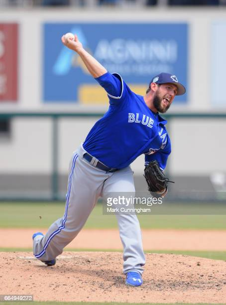 Dominic Leone of the Toronto Blue Jays pitches during the Spring Training game against the Detroit Tigers at Publix Field at Joker Marchant Stadium...