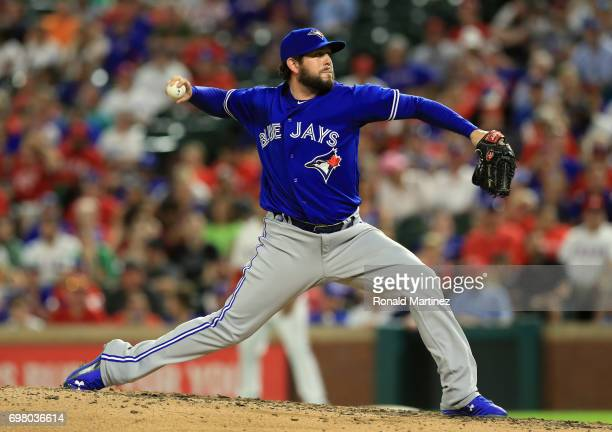 Dominic Leone of the Toronto Blue Jays throws against the Texas Rangers in the fourth inning at Globe Life Park in Arlington on June 19 2017 in...
