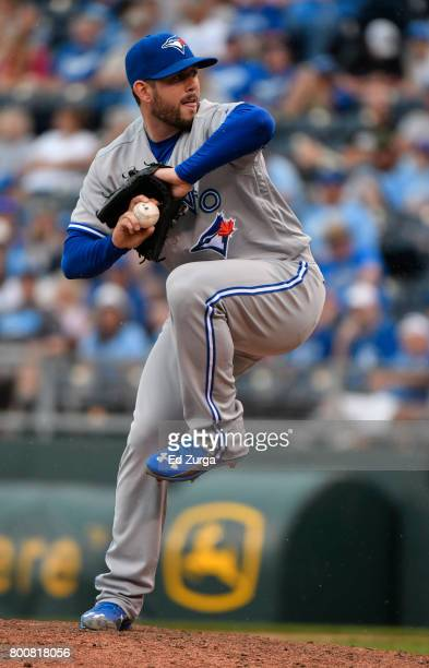 Dominic Leone of the Toronto Blue Jays throws in the eighth inning against the Kansas City Royals at Kauffman Stadium on June 25 2017 in Kansas City...