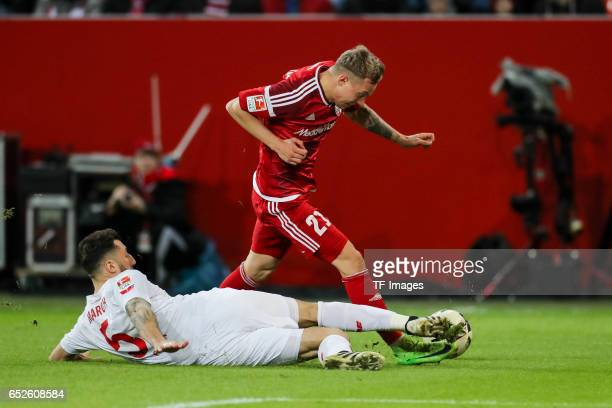 Dominic Maroh of Cologne and Leonardo Jesus Bittencourt of Cologne battle for the ball during the Bundesliga match between FC Ingolstadt 04 and 1 FC...