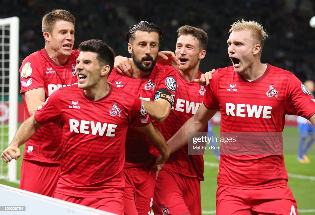Dominic Maroh (C) of Koeln jubilates with team mates after scoring the second goal during the DFB Cup match between Hertha BSC and 1. FC Koeln at Olympiastadion on October 25, 2017 in Berlin, Germany.