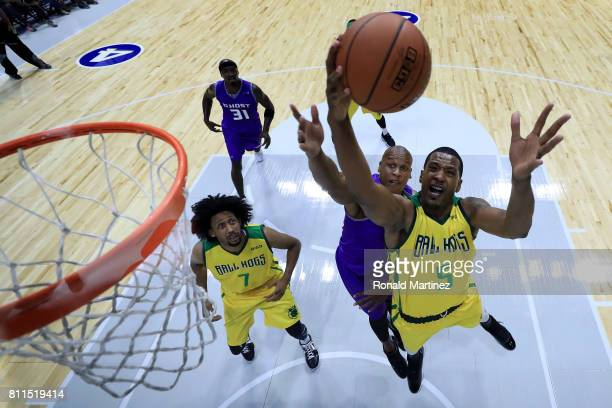 Dominic McGuire of the Ball Hogs grabs a rebound while being guarded by Mo Evans of the Ghost Ballers during week three of the BIG3 three on three...