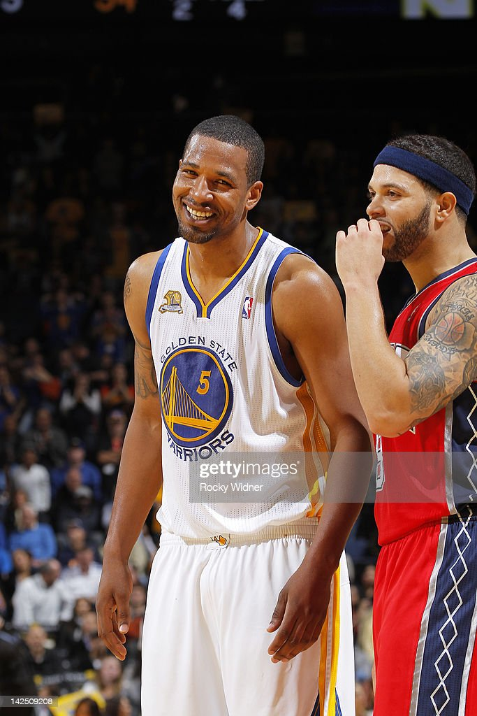 Dominic McGuire of the Golden State Warriors and Deron Williams of the New Jersey Nets exchange some banter during the game on March 30 2012 at...