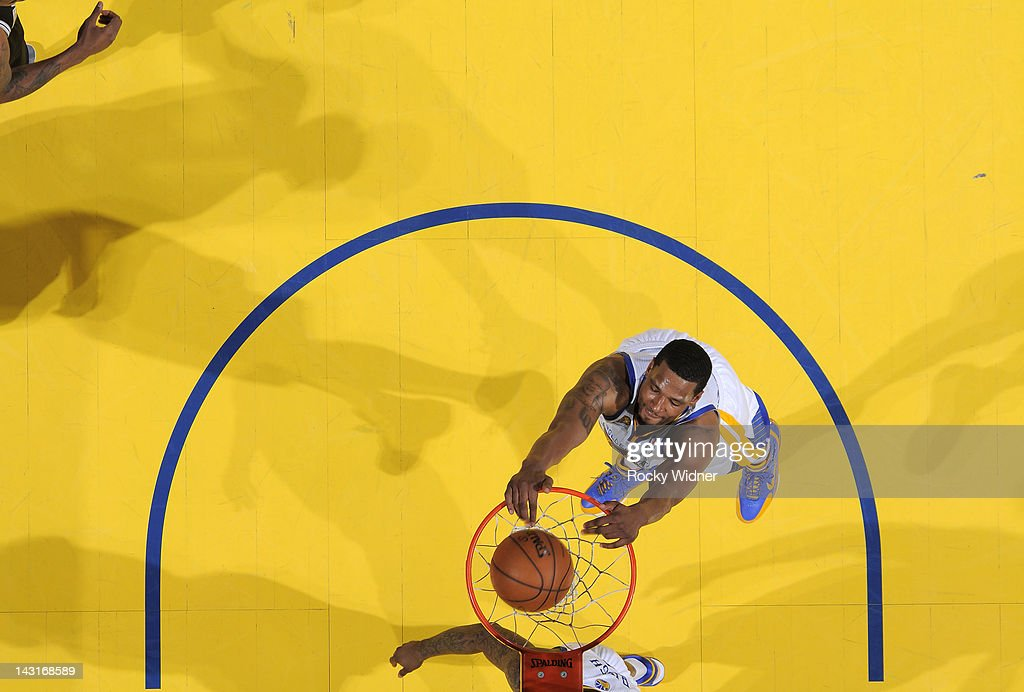 Dominic McGuire of the Golden State Warriors dunks the ball against the San Antonio Spurs on April 16 2012 at Oracle Arena in Oakland California NOTE...