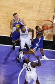 Dominic McGuire of the Golden State Warriors goes up for the rebound against the Sacramento Kings on March 13 2012 at Power Balance Pavilion in...