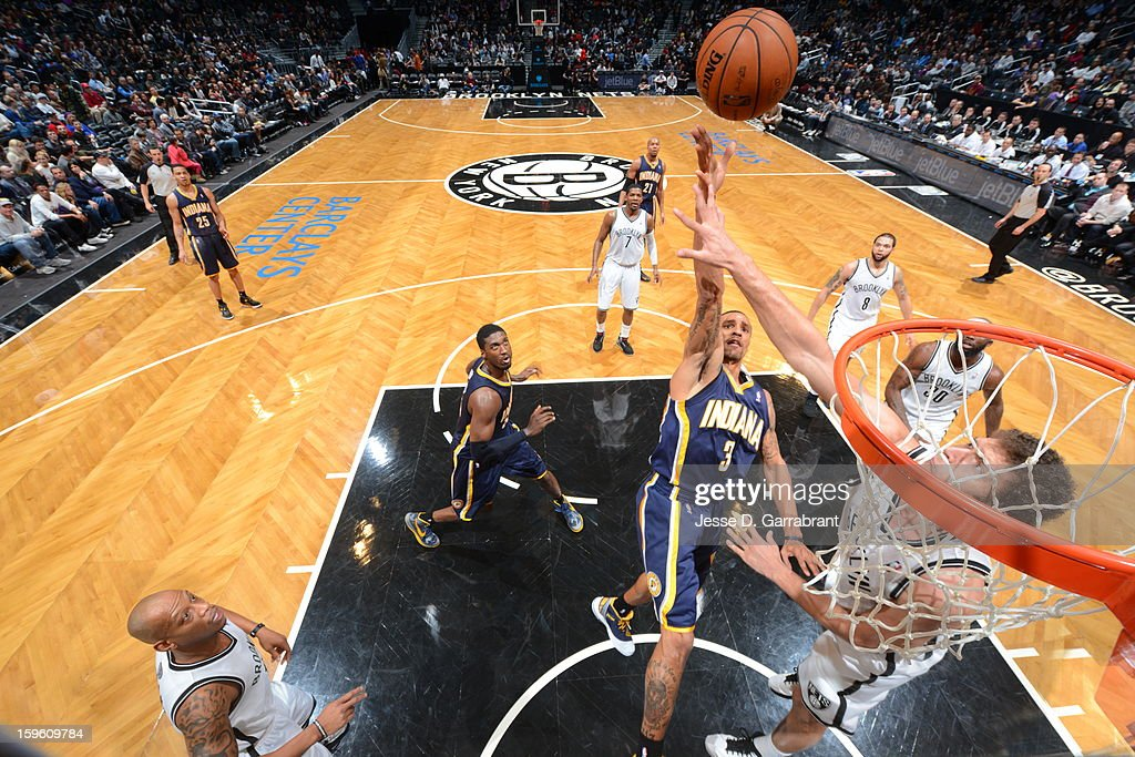 <a gi-track='captionPersonalityLinkClicked' href=/galleries/search?phrase=Dominic+McGuire&family=editorial&specificpeople=2537986 ng-click='$event.stopPropagation()'>Dominic McGuire</a> #5 of the Indiana Pacers shoots the ball against the Brooklyn Nets during the game at the Barclays Center on January 13, 2013 in Brooklyn, New York.