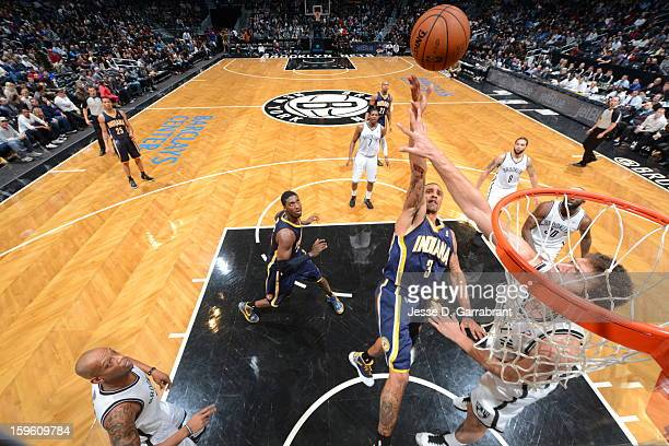 Dominic McGuire of the Indiana Pacers shoots the ball against the Brooklyn Nets during the game at the Barclays Center on January 13 2013 in Brooklyn...