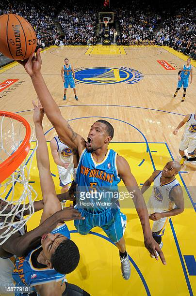 Dominic McGuire of the New Orleans Hornets attempts to tip the ball in against the Golden State Warriors on December 18 2012 at Oracle Arena in...