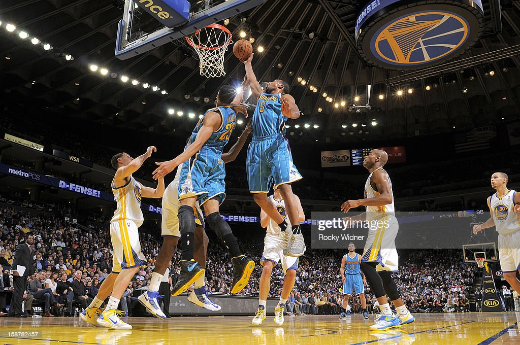 Dominic McGuire #5 of the New Orleans Hornets attempts to tip the ball in against the Golden State Warriors on December 18, 2012 at Oracle Arena in Oakland, California.