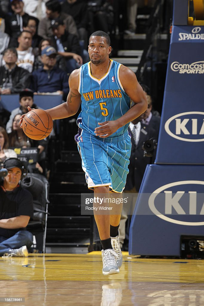 Dominic McGuire #5 of the New Orleans Hornets brings the ball up the court against the Golden State Warriors on December 18, 2012 at Oracle Arena in Oakland, California.