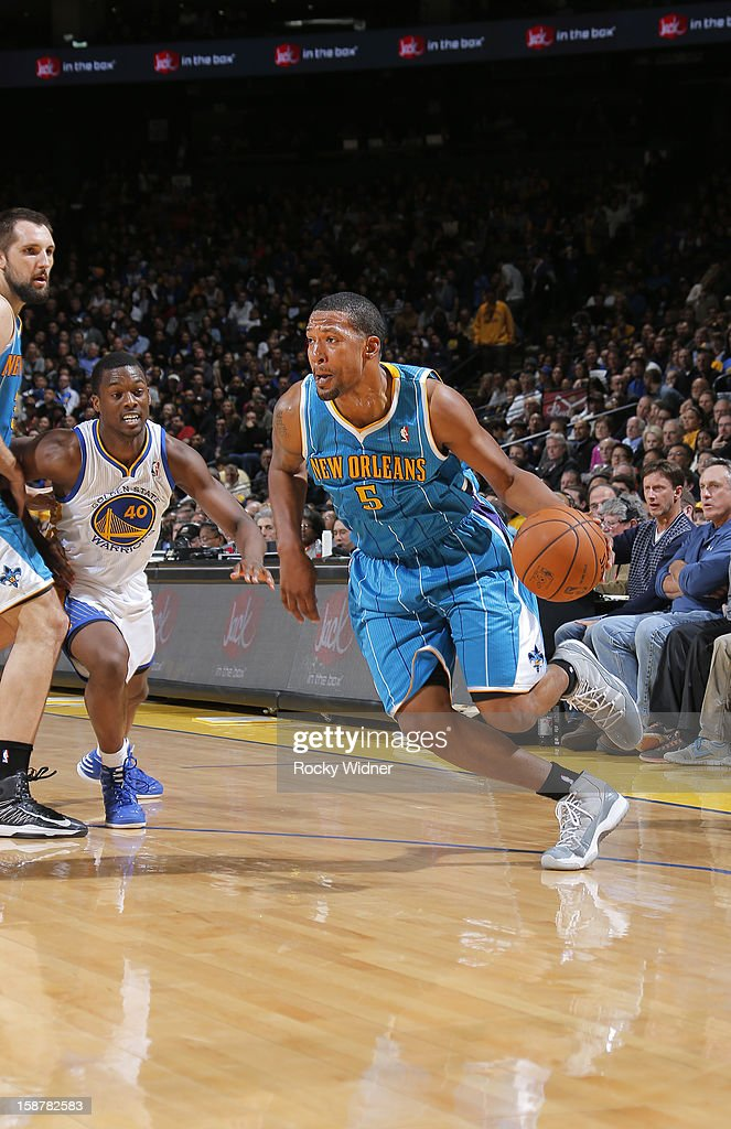 Dominic McGuire of the New Orleans Hornets drives to the hoop against Harrison Barnes of the Golden State Warriors on December 18 2012 at Oracle...