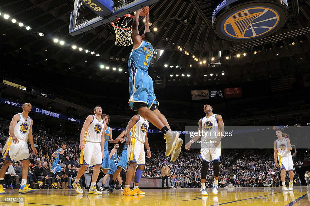 Dominic McGuire #5 of the New Orleans Hornets dunks the ball in against the Golden State Warriors on December 18, 2012 at Oracle Arena in Oakland, California.