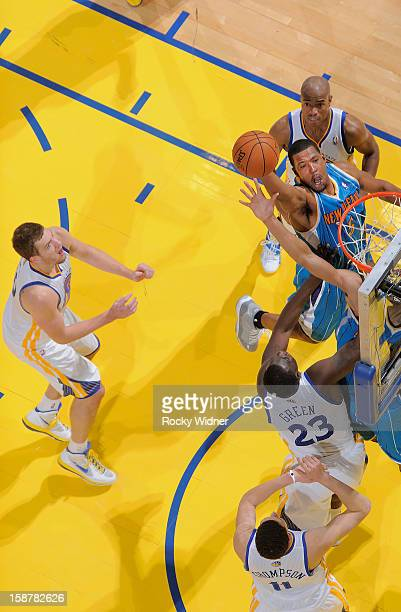 Dominic McGuire of the New Orleans Hornets goes up for a shot against Draymond Green of the Golden State Warriors on December 18 2012 at Oracle Arena...