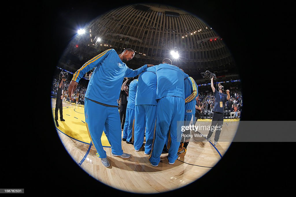 Dominic McGuire #5 of the New Orleans Hornets huddle with his teammates before facing off against the Golden State Warriors on December 18, 2012 at Oracle Arena in Oakland, California.