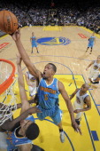 Dominic McGuire of the New Orleans Hornets reaches for a rebound against the Golden State Warriors on December 18 2012 at Oracle Arena in Oakland...