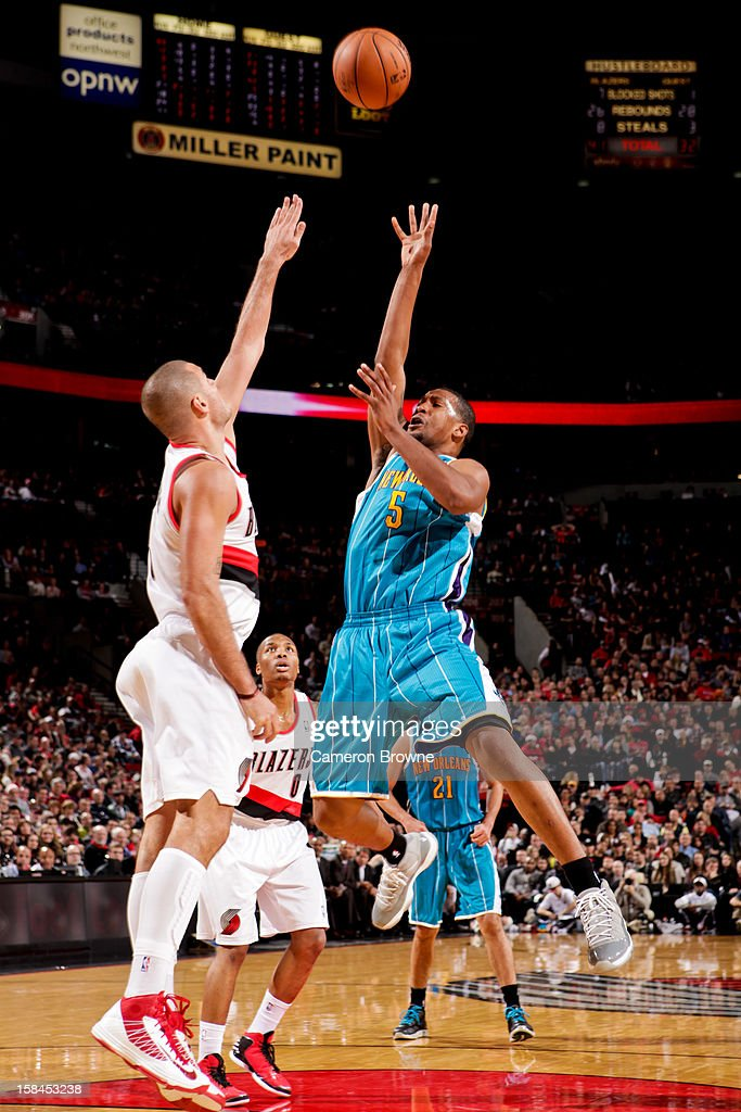<a gi-track='captionPersonalityLinkClicked' href=/galleries/search?phrase=Dominic+McGuire&family=editorial&specificpeople=2537986 ng-click='$event.stopPropagation()'>Dominic McGuire</a> #5 of the New Orleans Hornets shoots in the lane against Sasha Pavlovic #3 of the Portland Trail Blazers on December 16, 2012 at the Rose Garden Arena in Portland, Oregon.