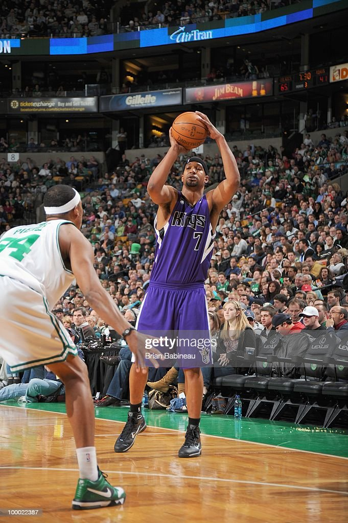 Dominic McGuire of the Sacramento Kings takes a shot against Paul Pierce of the Boston Celtics on March 26 2010 at the TD Garden in Boston...