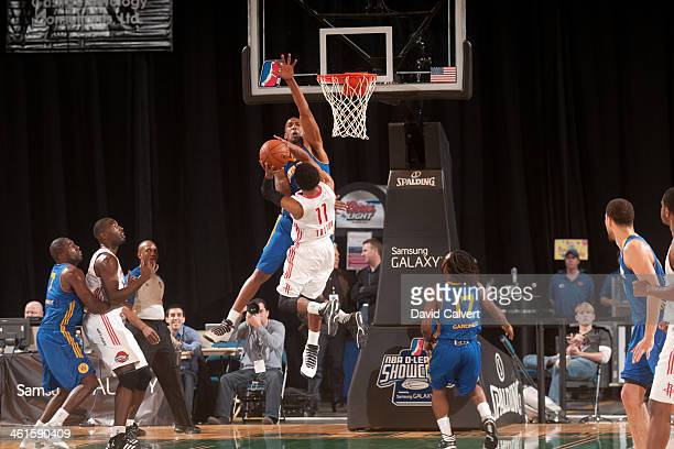 Dominic McGuire of the Santa Cruz Warriors attempts to block a shot against Gary Talton of the Rio Grande Valley Vipers during the 2014 NBA DLeague...