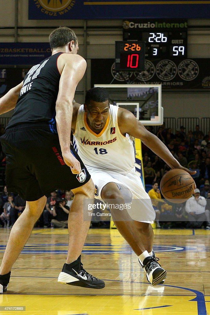 Dominic McGuire of the Santa Cruz Warriors drives to the basket against Jeff Foote of the Springfield Armor on February 21 2014 at Kaiser Permanente...