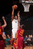 Dominic McGuire of the Santa Cruz Warriors shoots over defender Jamaal Franklin of the Fort Wayne Mad Ants during the 2014 NBA DLeague Showcase on...
