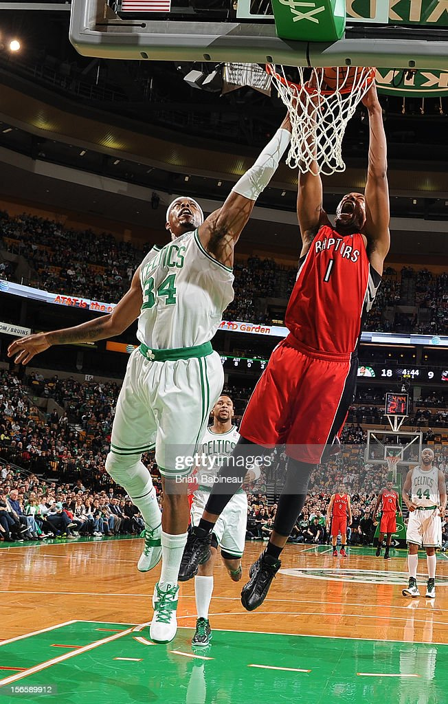 Dominic McGuire #1 of the Toronto Raptors dunks the ball against Paul Pierce #34 of the Boston Celtics on November 17, 2012 at the TD Garden in Boston, Massachusetts.