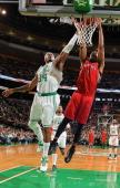 Dominic McGuire of the Toronto Raptors dunks the ball against Paul Pierce of the Boston Celtics on November 17 2012 at the TD Garden in Boston...