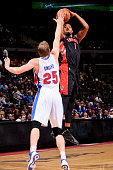Dominic McGuire of the Toronto Raptors shoots a threepointer against Kyle Singler of the Detroit Pistons on November 23 2012 at The Palace of Auburn...
