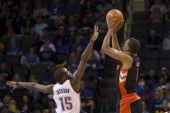 Dominic McGuire of the Toronto Raptors shoots over Reggie Jackson of the Oklahoma City Thunder during the NBA basketball game on November 6 2012 at...
