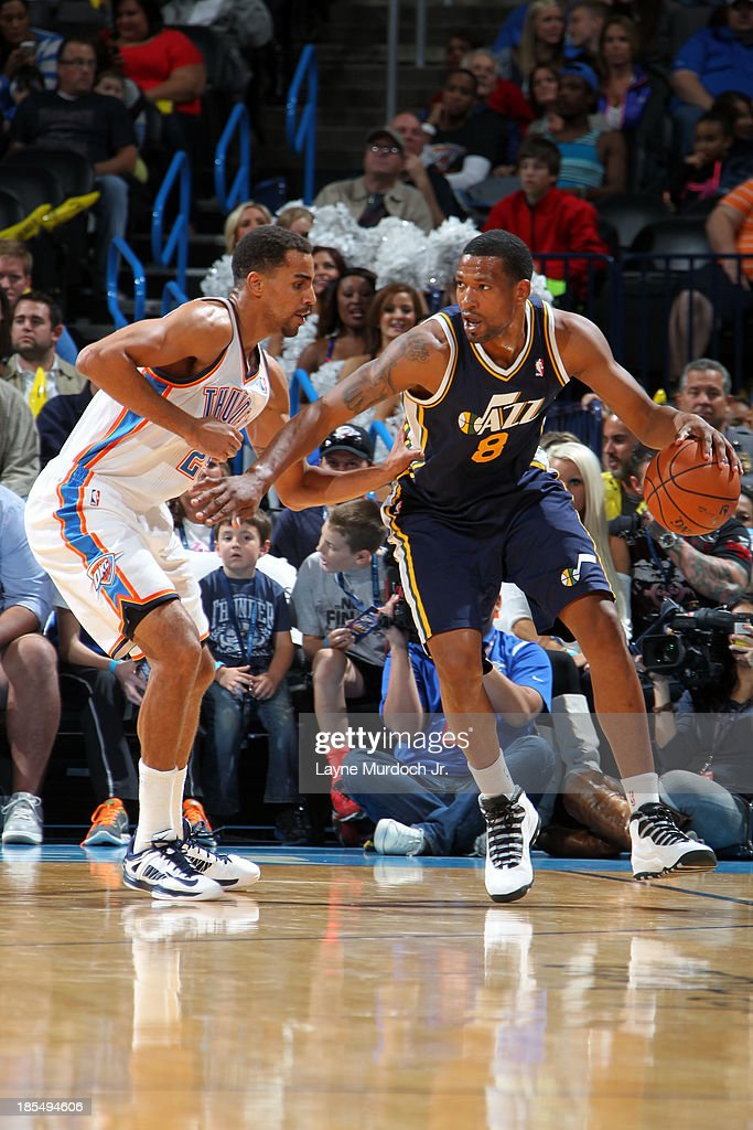 <a gi-track='captionPersonalityLinkClicked' href=/galleries/search?phrase=Dominic+McGuire&family=editorial&specificpeople=2537986 ng-click='$event.stopPropagation()'>Dominic McGuire</a> #8 of the Utah Jazz dribbles the ball while looking to pass against the Oklahoma City Thunder during an NBA preseason game on October 20, 2013 at the Chesapeake Energy Arena in Oklahoma City, Oklahoma.