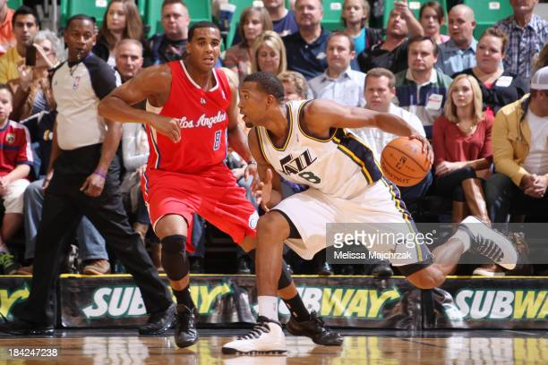Dominic McGuire of the Utah Jazz drives against Brandon Davies of the Los Angeles Clippers at Energy Solutions Arena on October 12 2013 in Salt Lake...