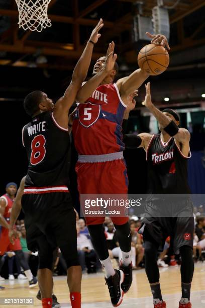 Dominic McGuire of TriState attempts a shot between James White and Kenyon Martin of Trilogy during week five of the BIG3 three on three basketball...
