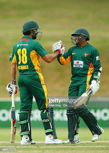 Dominic Michael of the Tigers celebrates and shakes hands with Clive Rose after scoring a century during the Matador BBQs One Day Cup match between...