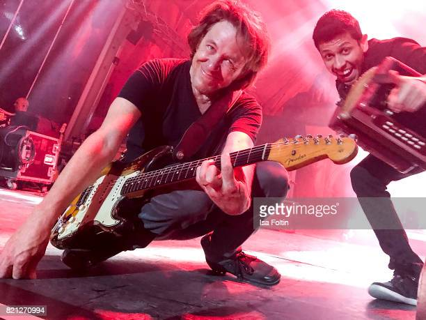 Dominic Miller and Percey Cardona perform on stage during the Sting concert at Thurn Taxis Castle Festival 2017 on July 22 2017 in Regensburg Germany