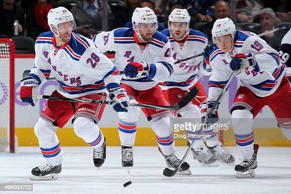Dominic Moore Jarret Stoll Keith Yandle and Jesper Fast of the New York Rangers pursue the puck against the Colorado Avalanche at Pepsi Center on...