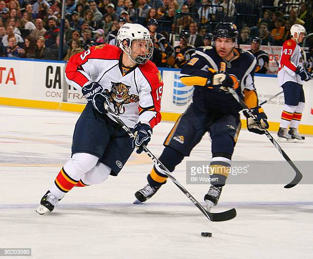 Dominic Moore of the Florida Panthers handles the puck against Derek Roy of the Buffalo Sabres on November 18 2009 at HSBC Arena in Buffalo New York