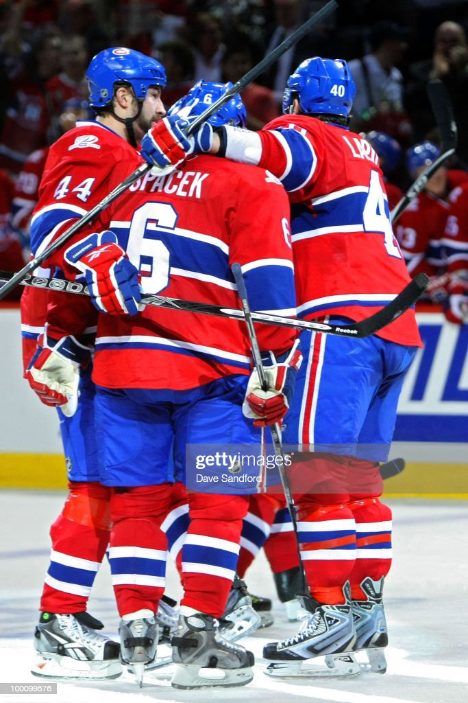 Dominic Moore #42 of the Montreal Canadiens celebrates with his team after scoring a goal against the Philadelphia Flyers second period of Game 3 of the Eastern Conference Finals during the 2010 NHL Stanley Cup Playoffs at Bell Centre on May 20, 2010 in Montreal, Canada.