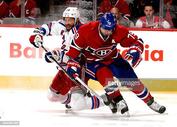 Dominic Moore of the New York Rangers and Andrei Markov of the Montreal Canadiens battle for the puck during Game Five of the Eastern Conference...