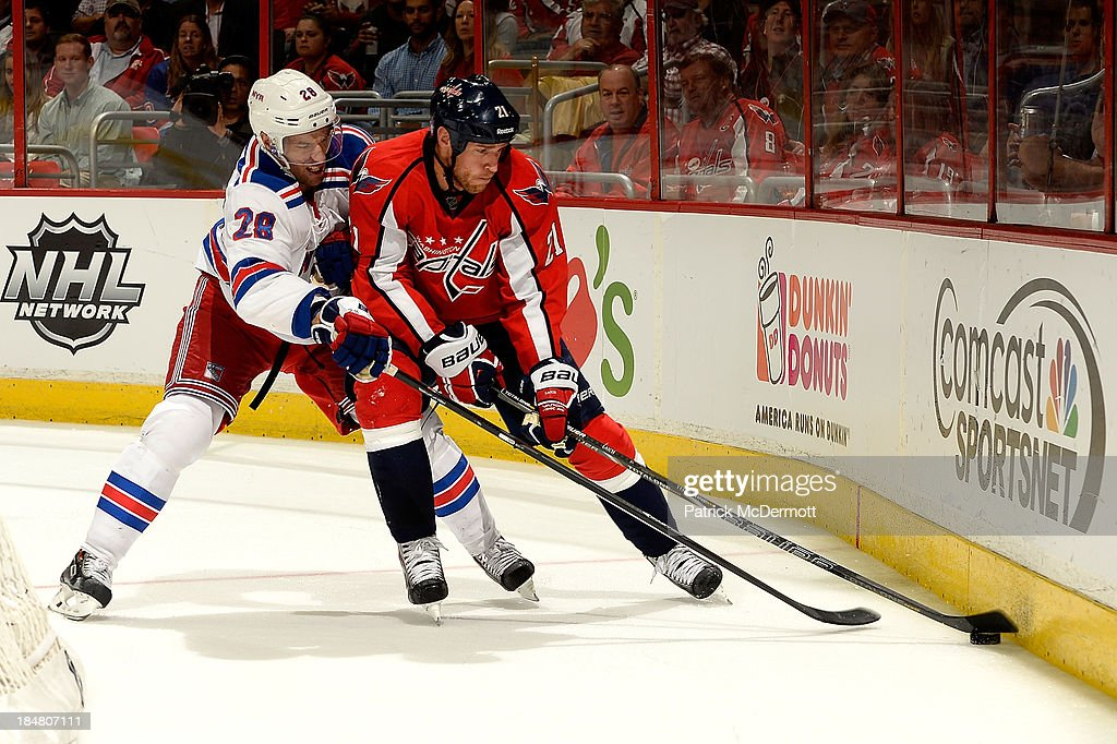 <a gi-track='captionPersonalityLinkClicked' href=/galleries/search?phrase=Dominic+Moore&family=editorial&specificpeople=223982 ng-click='$event.stopPropagation()'>Dominic Moore</a> #28 of the New York Rangers and <a gi-track='captionPersonalityLinkClicked' href=/galleries/search?phrase=Brooks+Laich&family=editorial&specificpeople=554432 ng-click='$event.stopPropagation()'>Brooks Laich</a> #21 of the Washington Capitals battle along the boards during the third period of an NHL game at Verizon Center on October 16, 2013 in Washington, DC.