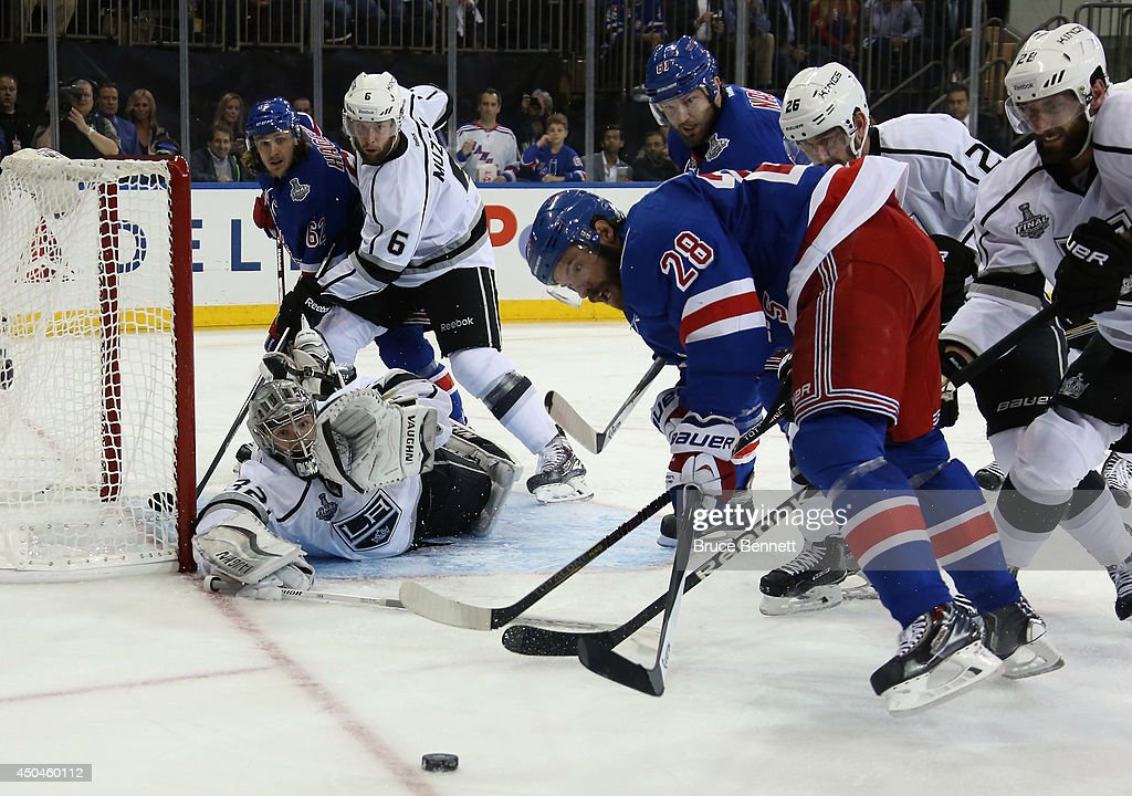Dominic Moore #28 of the New York Rangers and Jonathan Quick #32 of the Los Angeles Kings track the puck during the second period of Game Four of the 2014 NHL Stanley Cup Final at Madison Square Garden on June 11, 2014 in New York, New York.
