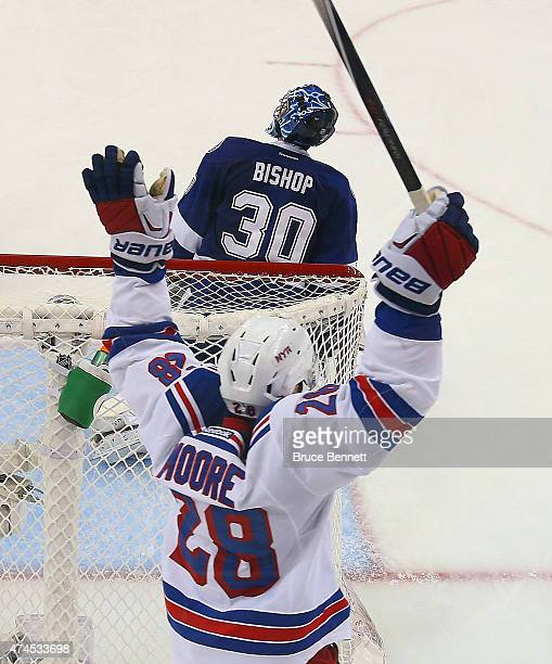 Dominic Moore of the New York Rangers celebrates a Ranger goal against Ben Bishop of the Tampa Bay Lightning in Game Four of the Eastern Conference...