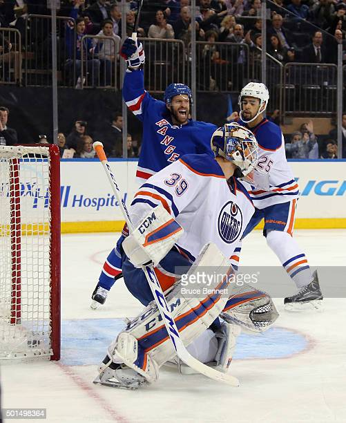 Dominic Moore of the New York Rangers celebrates a second period goal by Dylan McIlrath against Anders Nilsson of the Edmonton Oilers at Madison...