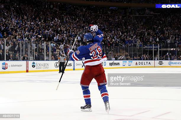 Dominic Moore of the New York Rangers celebrates his second period goal at 1807 against the Montreal Canadiens during Game Six of the Eastern...