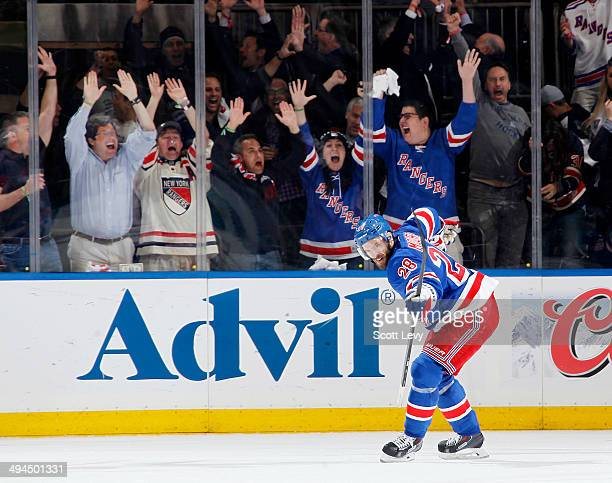 Dominic Moore of the New York Rangers celebrates scoring a goal in the second period of Game Six of the Eastern Conference Final against the Montreal...