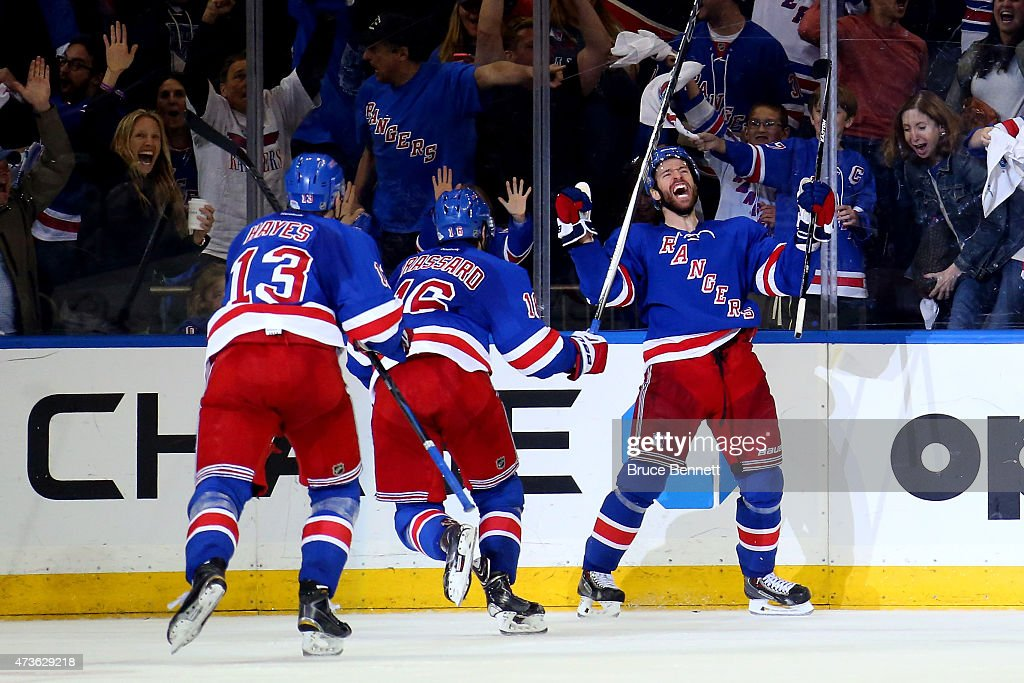 <a gi-track='captionPersonalityLinkClicked' href=/galleries/search?phrase=Dominic+Moore&family=editorial&specificpeople=223982 ng-click='$event.stopPropagation()'>Dominic Moore</a> #28 of the New York Rangers celebrates the game-winning goal in the third period against the Tampa Bay Lightning in Game One of the Eastern Conference Finals during the 2015 NHL Stanley Cup Playoffs at Madison Square Garden on May 16, 2015 in New York City. The Rangers defeated the Lightning 2-1.