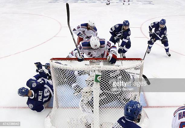 Dominic Moore of the New York Rangers crashes the net against the Tampa Bay Lightning in Game Three of the Eastern Conference Finals during the 2015...