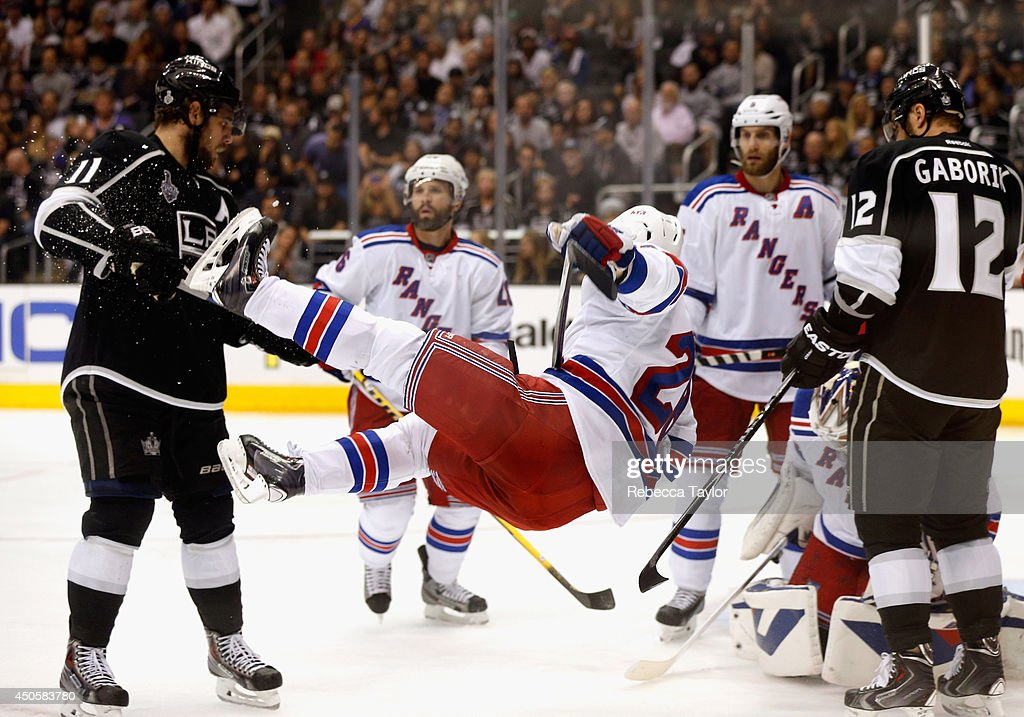 Dominic Moore of the New York Rangers gets upended in front of Anze Kopitar of the Los Angeles Kings during the second period of Game Five of the...