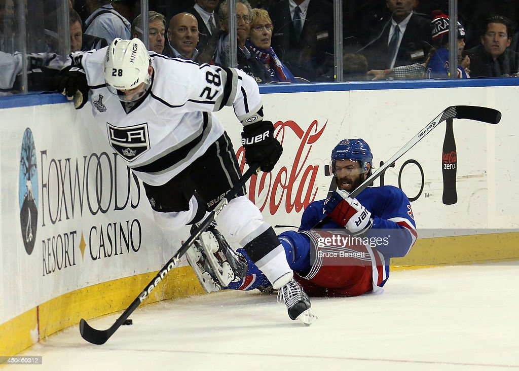 Dominic Moore #28 of the New York Rangers lies on the ice after a collision with Jarret Stoll #28 of the Los Angeles Kings during the second period of Game Four of the 2014 NHL Stanley Cup Final at Madison Square Garden on June 11, 2014 in New York, New York.