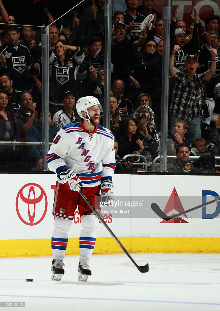 Dominic Moore #28 of the New York Rangers reacts after receiving a penalty for a high stick on Jeff Carter #77 of the Los Angeles Kings (not pictured) during overtime of Game Two of the 2014 Stanley Cup Final at Staples Center on June 7, 2014 in Los Angeles, California.