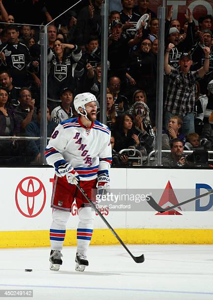 Dominic Moore of the New York Rangers reacts after receiving a penalty for a high stick on Jeff Carter of the Los Angeles Kings during overtime of...